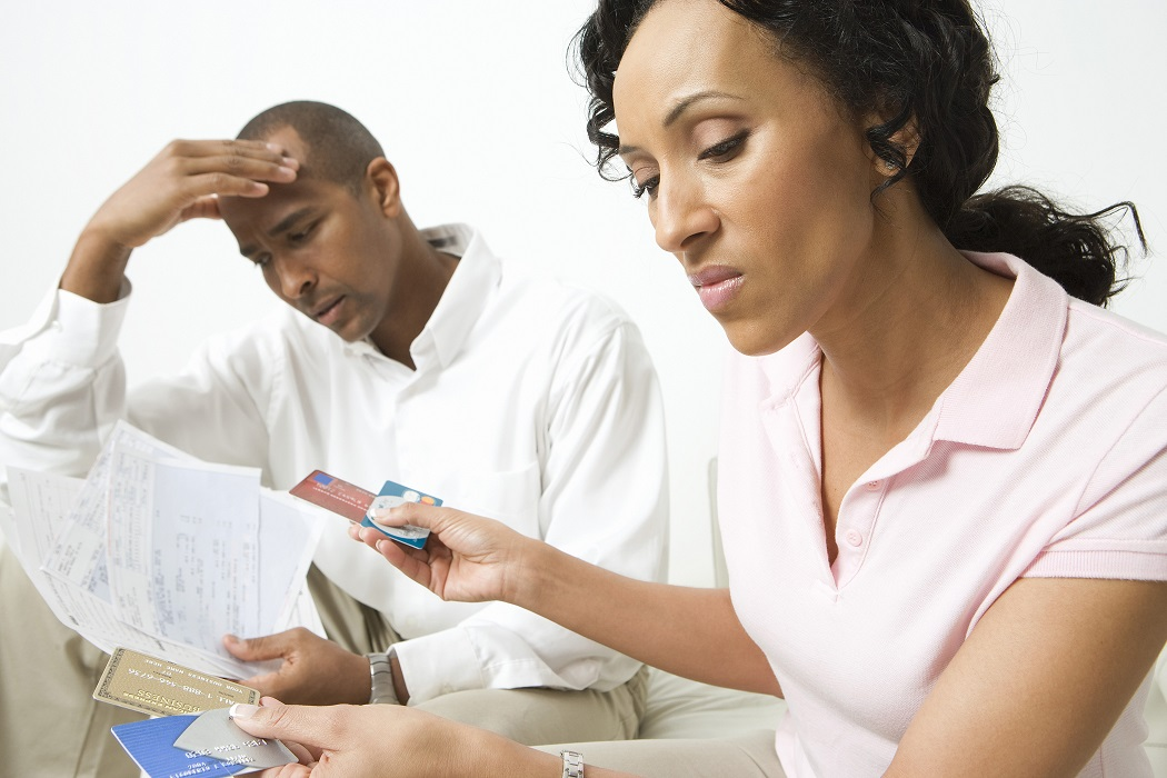 Angry Couple With Credit Cards And Bills