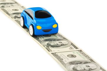 Car on money road