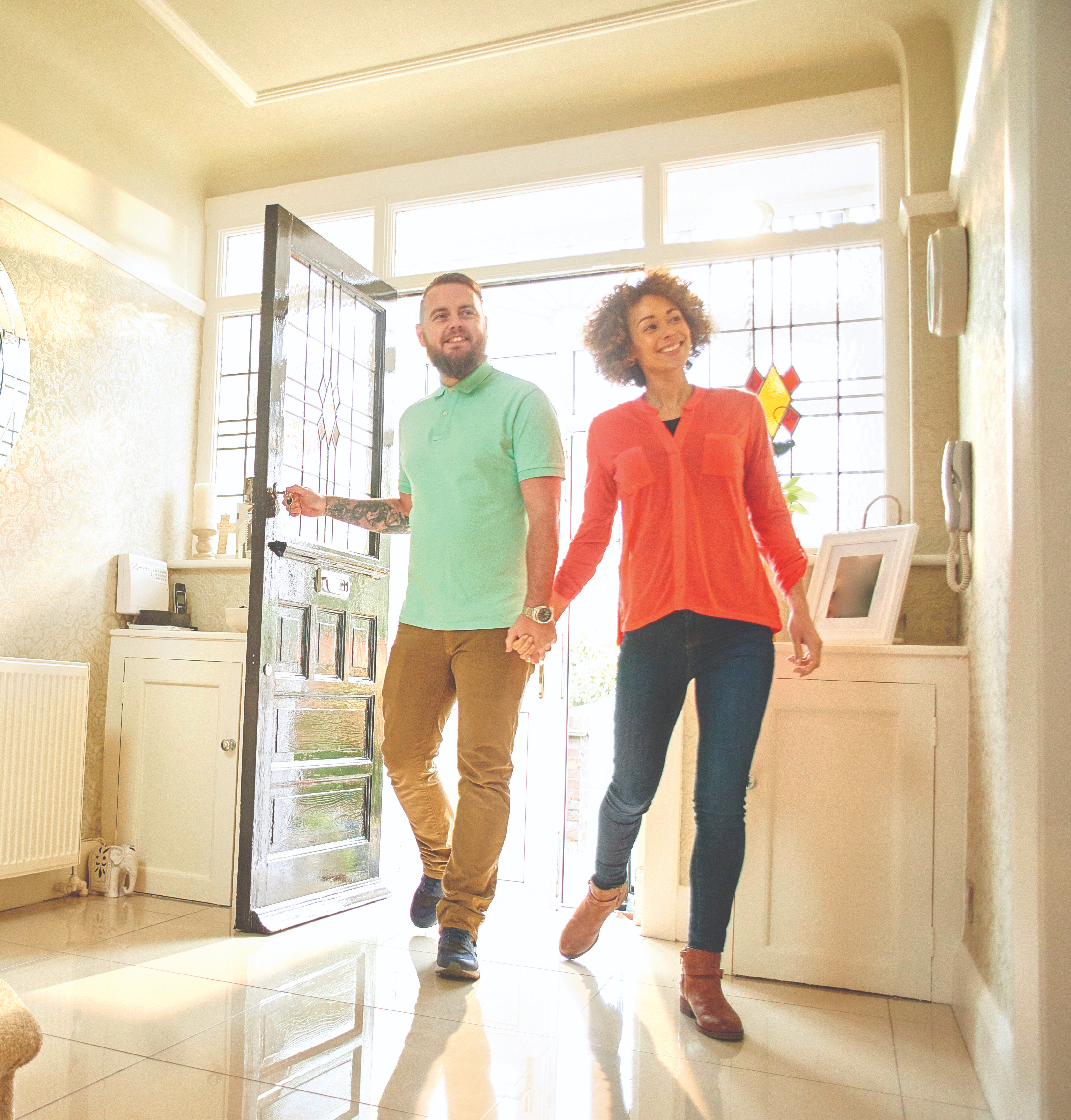 excited couple with keys to new home