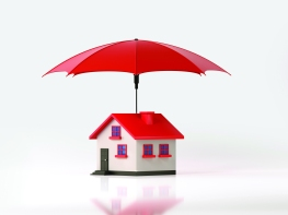 Red Umbrella Protecting A Toy House On White Background: Insurance And Real Estate Concept